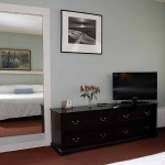 Dresser and television in room at Hotel Coolidge