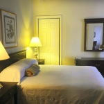Bed and dresser at Hotel Coolidge